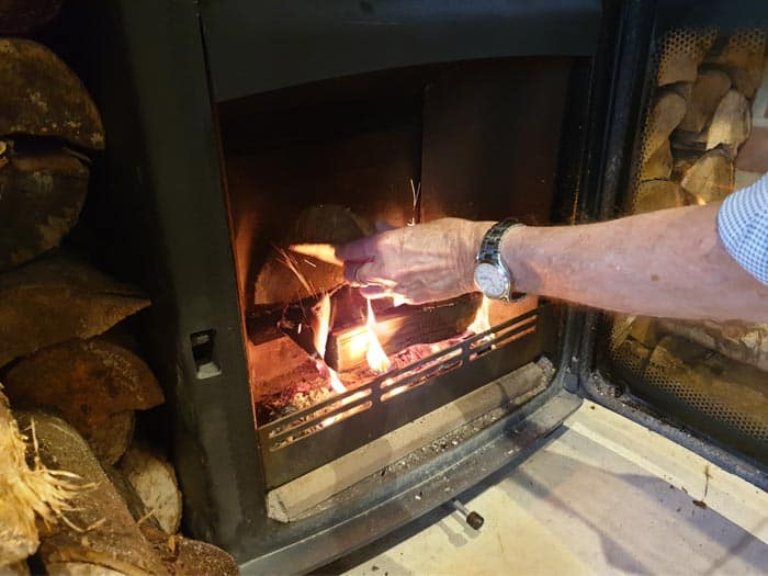Wood Burning Stove Adding Logs